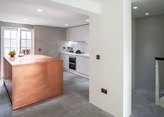 A copper box inspired by Minimalist artist Donald Judd forms an island in the middle of this kitchen.