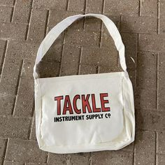 Canvas Shoulder Bag – TACKLE Instrument Supply Co. Waxed Canvas, Cotton Canvas, Cotton Bandanas, Shop Rags, Canvas Shoulder Bag, Bag Accessories, Instruments, Pouch, Reusable Tote Bags