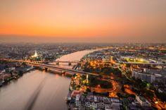 Sunset at Chao Phraya River, Grand Palace, Wat Phra Kaeo Bridge in Bangkok_ Thailand