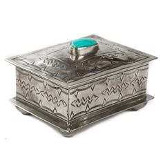 Story  A keepsake box that's a keepsake itself  Drawing inspiration from early Navajo silversmiths, J. Alexander produces a line of homegoods that are handmade by skilled artisans in the Central Highlands of Mexico. The small stamped box is a gorgeous nickel silver box that is perfect for small accessories and treasures alike. Features  Natural turquoise stone Nickel silver alloy doesn't tarnish Navajo inspired designs  Materials   Nickel Silver   Nickel silver is an alloy containing copper…