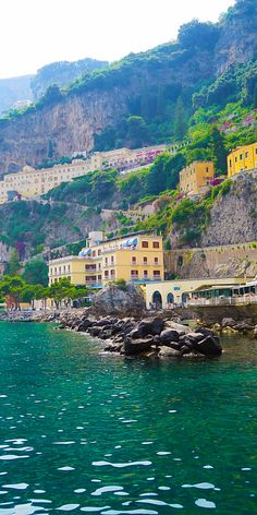 Amalfi Coast, Italy | A popular holiday destination, this famous Italian region possesses sheer cliffs and a rugged shoreline dotted with small beaches and pastel-colored fishing villages.