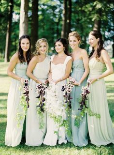 love these similar shades of green with different styled dresses... and the bouquets are very interesting!