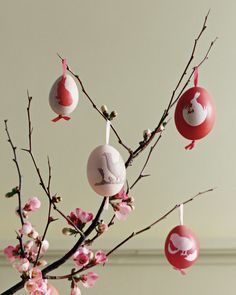 Bring the whimsy of scherenschnitte, the German art of paper cutting, to your tabletop decor. Blown-out eggs, dyed and adorned with seasonal silhouettes, look delightful dangling from a cluster of quince branches. Eggs can also be inscribed with guests' names and double as place cards and charming favors.