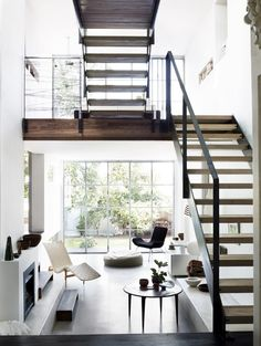 Modern/contemporary architecture with glass windows and open staircase... nice. Oak Staircase/Plenty of Light