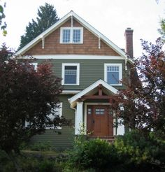 craftsman exterior, green siding and cedar shakes