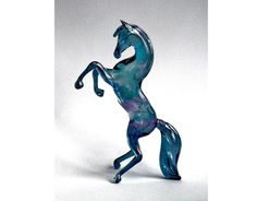 Four-Inch Rearing Glass Horse, handmade in the UK. £14.95, via Etsy.