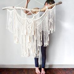 Large Macrame Wall hanging  A fusion knots and of course lots of fringing! The star of this piece is a beautiful long branch.  Your piece is made by hand using natural unbleached cotton and revived branches from local woods in Upstate NY and the Adirondacks. ✨✨✨  SIZING She measures roughly 44in x 45in (from nail height to longest rope on macrame) so she is sure to stand out wherever you choose to hang her.  Sizing is approximate: Branch Width - 44 Macrame Length - 36 Rope hanger- 12 ✨✨✨…