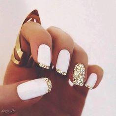 Trendy Nails with white base and gold glitter french tips. #nailart #nails #polish #mani - Share/explore more nail looks at bellashoot.com!