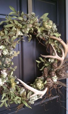 Wreath with antlers -- I have the wreath and antlers already! Would be great Fall wreath if you added some hints of orange/rust and made a burlap bow :)