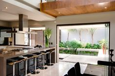 Beautiful #modern #kitchen + breakfast nook opening up to backyard | Nico Van Der Meulen