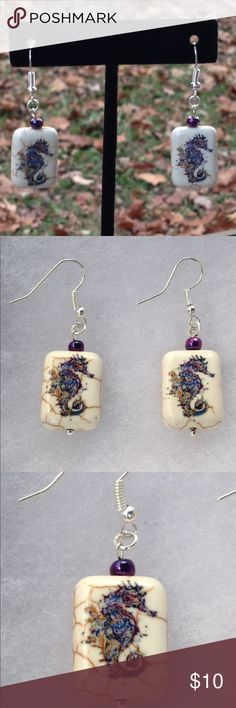 Stone Seahorse Earrings These beautiful earrings are made with reconstituted stone with a purple seahorse print. The hooks are sterling silver plated.   All PeaceFrog jewelry items are handmade by me! Take a look through my boutique for coordinating jewelry and more unique creations. PeaceFrog Jewelry Necklaces