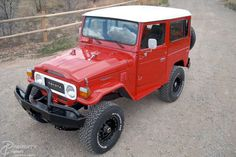 perfectly done red fj40 with black wheels