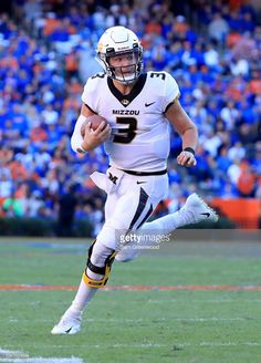 Drew Lock of the Missouri Tigers rushes for yardage during the game. 325bbc8c5