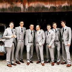 Gray suits, gray suits, dark ties and brown shoes look oh so sharp on all these Groomsman. All wearing suits from Generation Tux.