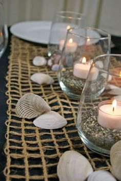 Jute burlap netting table runner. Great for nautical, beach or rustic themed events and weddings! http://www.lightsforalloccasions.com/p-4596-rustic-burlap-net-table-runner-10-in-x-10-yd-nautical-natural.aspx