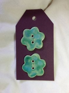 Handmade flower shape ceramic buttons - set of 2. on Etsy, £5.00