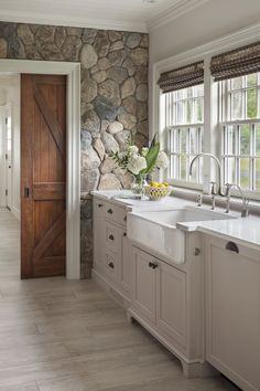 Interior Design Kitchen Farmhouse sink with white painted cabinetry set against cobbled stone wall. Design by Patrick Ahearn Architect - See why we're dying over this natural trend! Sweet Home, Cuisines Design, Kitchen Interior, Room Kitchen, Kitchen Rustic, Kitchen Stone Wall, 1930s Kitchen, Barn Kitchen, Country Kitchens