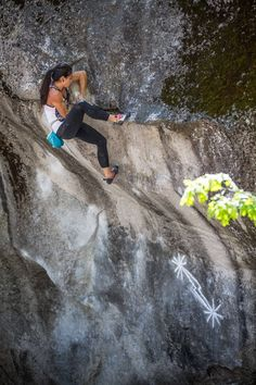 Nina mantling out Midnight Lightning -- the most iconic boulder problem out there.