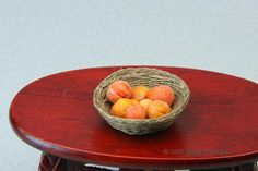 Learn to make a woven miniature fruit basket using embroidery thread and fine wire to be used in scale scenes or dollhouse displays.