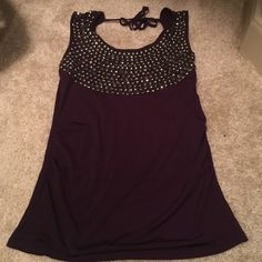 "Women dark purple top with sequins cute top, was worn couple times, size S to M                   Selling because your clothes don't fit anymore? want to wear smaller size? want to have "" ready for the beach"" body? want to have longer and stronger hair and nails? want to start your own business and make money? ask me about ""it works""!!!                                     WhatsApp +1 8329296524  Tops Tank Tops"