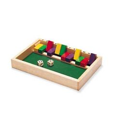 """Roll the dice, add up your score, and see how many """"giants"""" (wooden pegs) you can flip up. Our version of this traditional game is fun for any number of players, and for solo play. An ideal travel game. Felt-lined wooden game box comes with colorful pegs and two dice."""