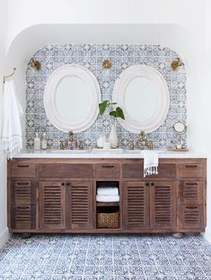 """The stunning master bathroom tile is also a callback to the original design of the home. """"A larger window in the shower and the addition of the decorative arch at the entrance of this..."""