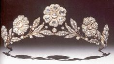 The Strathmore Rose diamond tiara was made around 1900 by Catchpole & Williams. Allegedly, The Earl if Strathmore gave it to his daughter ( Lady Elizabeth Bowes-Lyon, aka the Queen Mother) in 1923.  The tiara is feminine and beautiful; there are five large diamond roses separated by diamond sprays. Additionally the diamond roses can be fashioned into brooches.