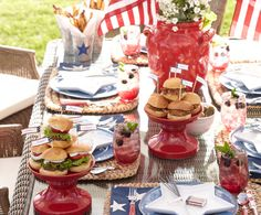 Burgers, pulled pork sandwiches, and freedom fries are on the menu at this 4th of July Party. White star-shaped plates, topped with sparklers and red-white-blue covered match boxes, are a nice touch!