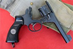 """Enfield No.2 Mk I Break open British revolver from World War II, the No.2 Mk I is often referred to as the """"Tanker"""". Supposedly it was designed with a bobbed or spur-less hammer to prevent snags when drawing from the holster or exiting a tank, per request of tank crews. The No.2 Mk I was issued to normal troops as well, but the Tanker name stuck. (GRH)"""