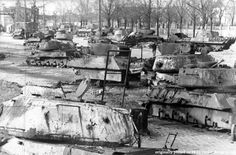Tanks destroyed during the battle of Berlin collected to be shipped for scrap metal. Two Tiger II's, a Panther, a SU-76 self-propelled gun, two Shermans, several IS-2's and a T-34/85 can be seen, 1945