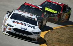 Racing around a tight turn in front of Kasey Kahne and Clint Bowyer Event: 2016 STP 500 (Martinsville)
