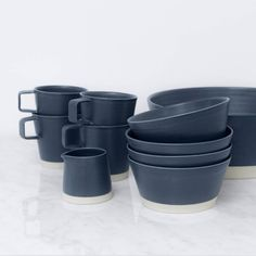 Featuring simple lines and a rich, navy blue glaze, this set of modern ceramics adds a touch of sophistication to any weekend soiree. Handmade in Ireland.