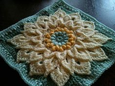The Crocodile Flower.Top 10 FREE granny square patterns by The Lavender Chair. #CrochetPatternsGrannySquares #MandalaCrochetPatterns