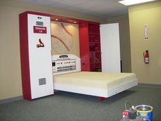 A bed that looks like a locker room! Talk about creative! This would be an awesome bedroom for any Chiefs fan!
