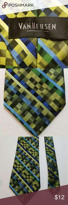 Van Heusen Mens Neck know Tie Gorgeous eye catching Van Heusen tie with bright vibrant color. The tie is in excellent pre-loved condition (like new) with no stains or signs of wear. Looks terrific dressed up or dressed down with jeans. The US made of 100% silk and treated with a stain resistant fabric protector and has an iridescent look in blue and green colors. Van Heusen Accessories Ties