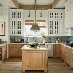 There's something so special about this kitchen  to me...wish it were in my house.  Coastal Living East Beach Idea House Kitchen