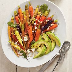 Roasted Carrots with Avocado and Feta Vinaigrette | 30 minutes | SouthernLiving.com