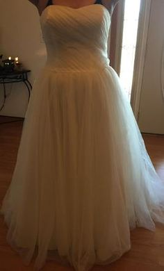 David's Bridal 10012273 14: buy this dress for a fraction of the salon price on PreOwnedWeddingDresses.com