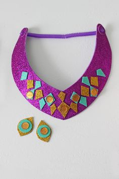 Princess jasmine necklace and stick on earrings DIY. This is a mess free craft that is perfect for an Aladdin party with kids.
