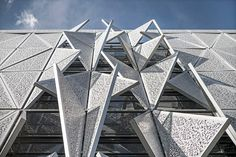 The solar-shading system is equipped with sensors that measure light and heat levels and continually adjust the façade's approximately 1,600 perforated steel triangular shutters with a small motor.