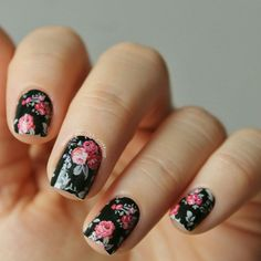 Floral print nails over black by @never_enough_glitteer