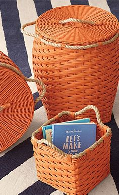 Bright orange baskets perfect for the summer season. It's easy to take any basket and spray paint it to match your color scheme!