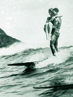 I believe this may be Doris Duke and her lover Duke Kahamaku