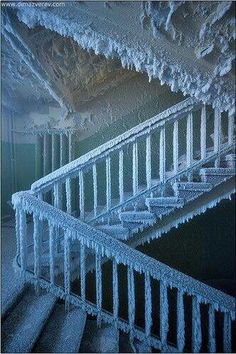 An iced over staircase in an abandoned house in Russia~
