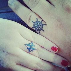 Great marriage tattoo idea. I like the symbolism in that, on a boat (since these are nautical), without one, the other is useless, they need each other. May not work in everyone's careers though