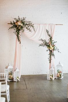 Beautiful draped wedding arch by Blossom Farm Vintage Rentals.