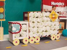 Truck Diaper Cake with Printable Paper Elements. Truck diaper cake with 100 HUGGIES® Pure & Natural Diapers.