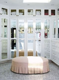 Wall storage with narrow divided doors, beveled mirror inserts.