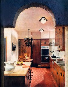 """""""THIS ROOM IS SO LIKE THE WAY OUR KITCHEN USED TO LOOK ... OURS HAD THE SAME CUPBOARDS AND A TERRA COTTA FLOOR! In 1968, House Beautiful described this kitchen in West Orange, New Jersey, as """"a bilingual kitchen designed for a couple who enjoy both coo..."""""""