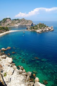 Taormina, Sicily, Italy. Too many steps to get down there and damn too many on the way up. It was always beautiful to see on all the curvy turns to get there. Glad i was the only one taking in the scenery on the way the. Those roads were treacherous.